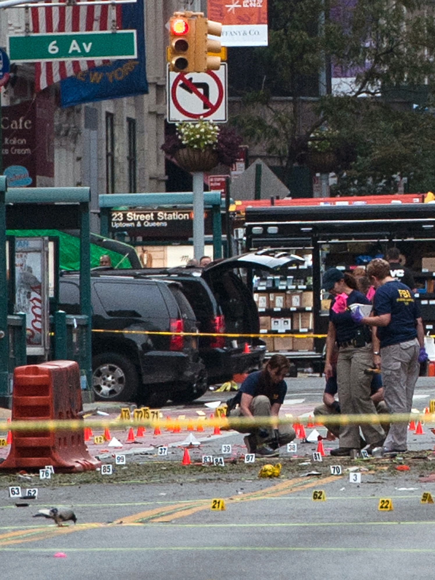 FBI agents review the crime scene of remnants of bomb debris on 23rd St. in Manhattan's Chelsea neighborhood on September 18, 2016 in New York City.
