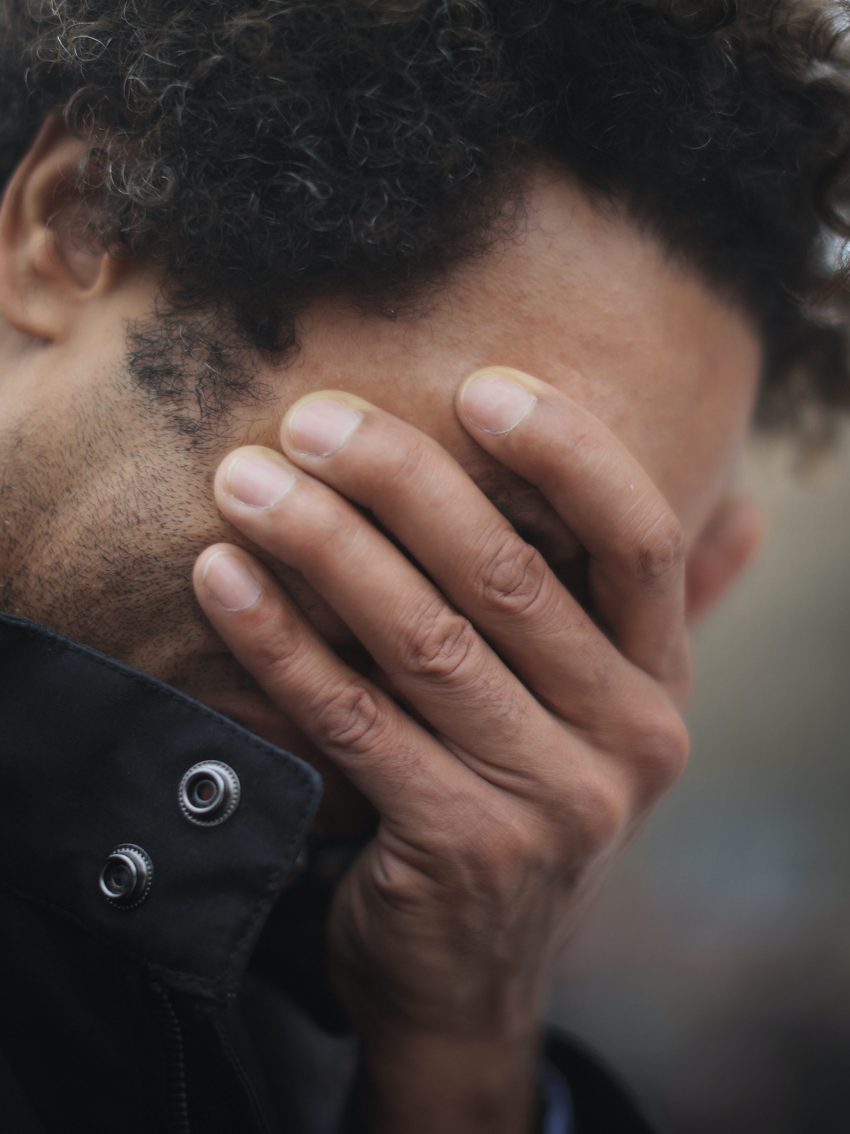 A man weeps for a lost friend as people gather to observe a minute-silence at the Place de la Republique in memory of the victims of the Paris terror attacks last Friday, on November 16, 2015 in Paris, France. Countries across Europe will join France, currently observing three days of national mourning, in a one minute-silence today in an expression of solidarity with the victims of the terrorist attacks, which left at least 129 people dead and hundreds more injured.