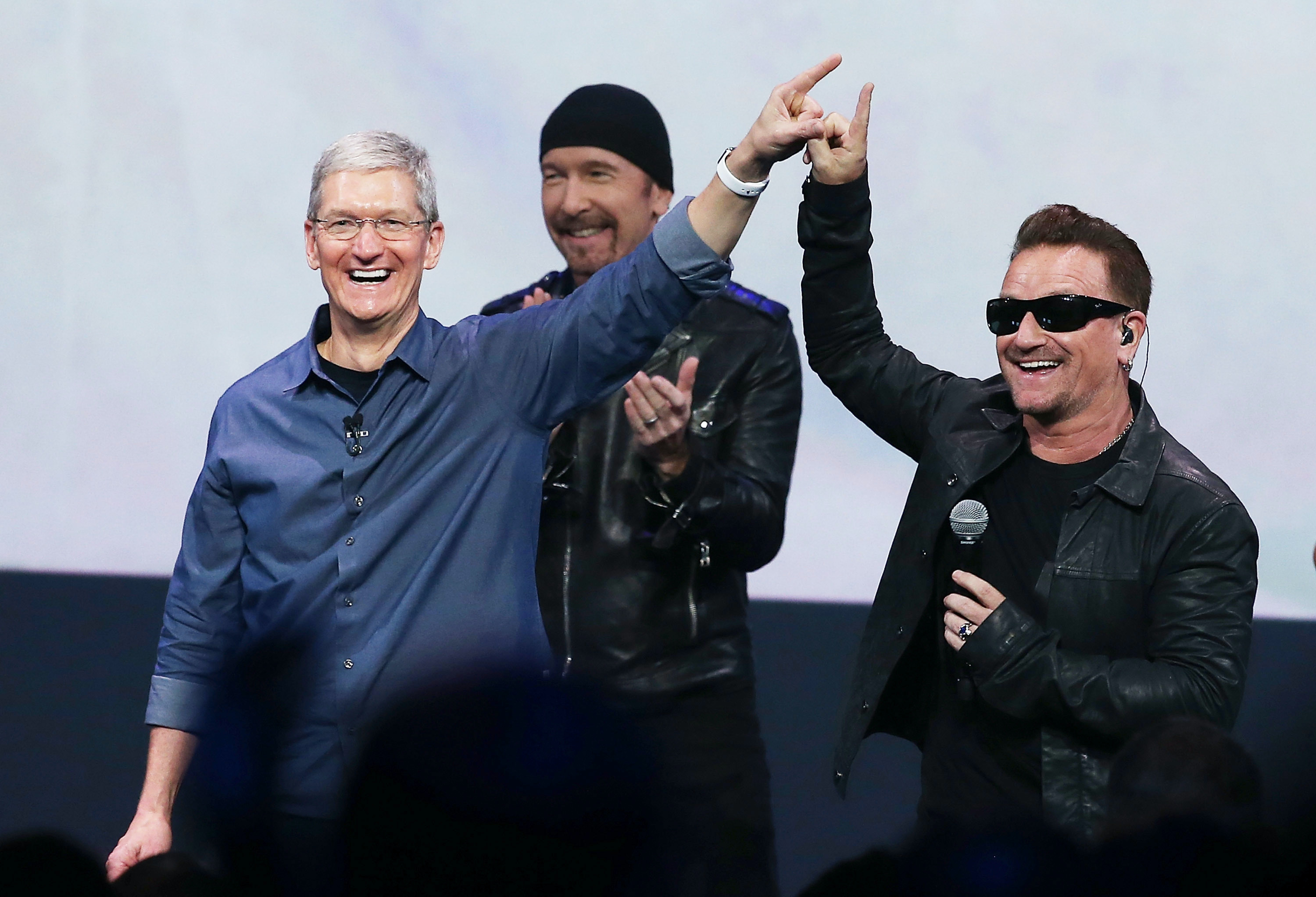 Tim Cook, seen here making human contact with Bono.