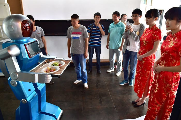 A robot waiter delivers meals for customers at robot-themed restaurant in China.