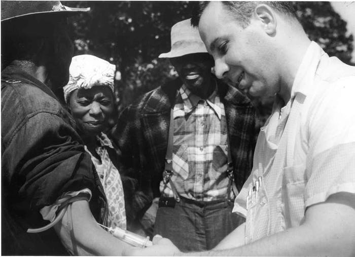 A doctor drawing blood from a patient as part of the Tuskegee Syphilis Study.