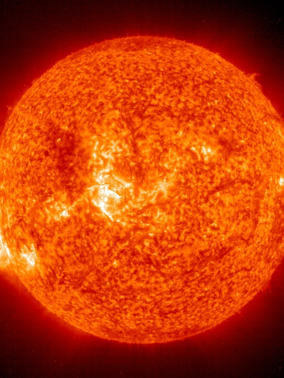 In this handout photo provided by NASA, a Solar and Heliospheric Observatory image shows Region 486 that unleashed a record flare last week (lower left) November 18, 2003 on the sun. The spot itself cannot yet be seen but large, hot, gas-filled loops above this region are visible. These post-flare loops are still active.
