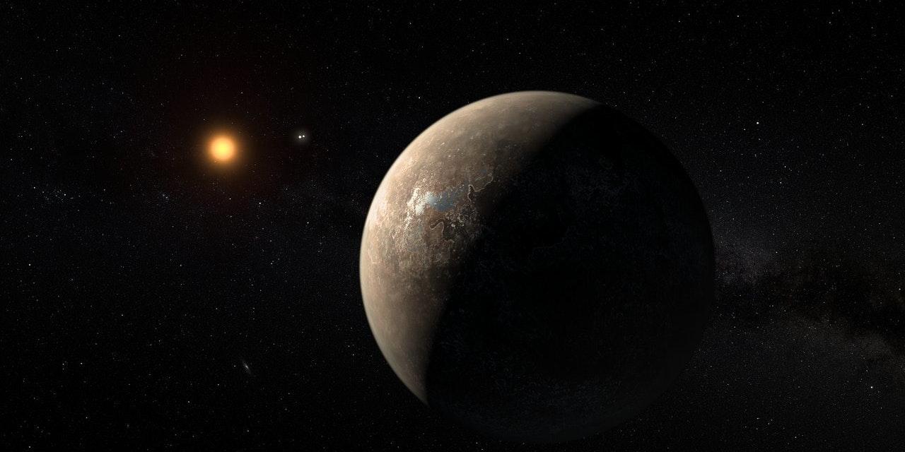 Artist's impression shows the planet Proxima b orbiting the red dwarf star Proxima Centauri