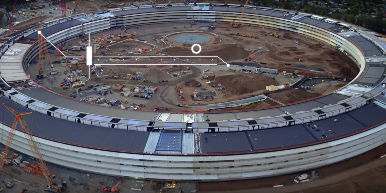 An aerial shot reveals the side of Apple's under-construction spaceship headquarters.