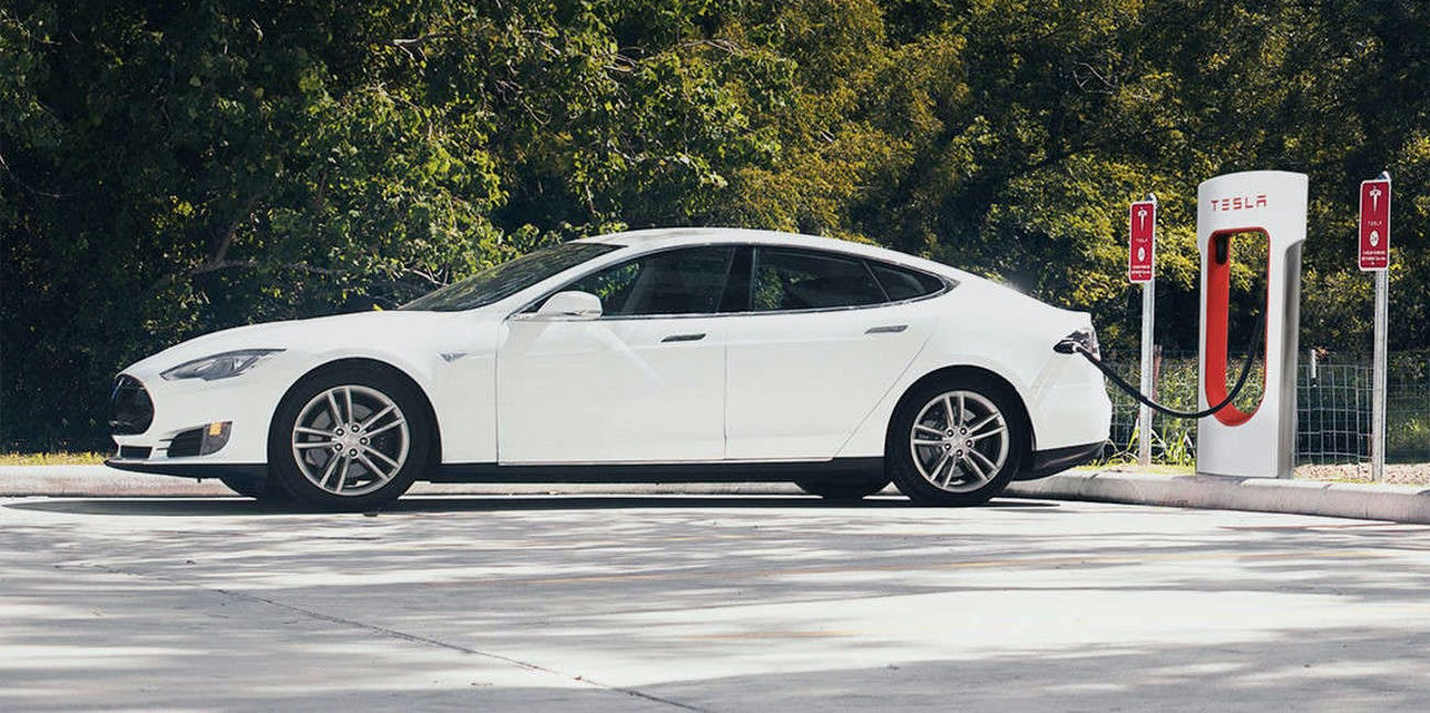 """Tesla owners will now have to pay """"a small fee"""" for Supercharging, after 1,000 free miles."""