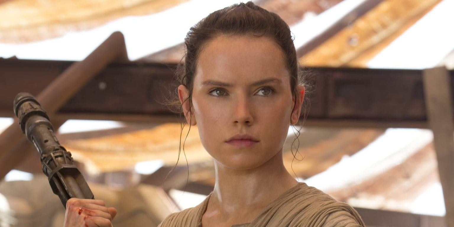 Rey with her staff in 'The Force Awakens'