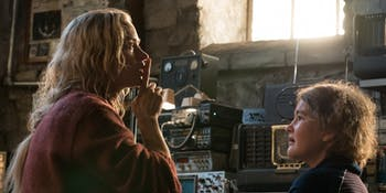 Evelyn Abbot (Emily Blunt) in 'A Quiet Place' next to her daughter Regan (Millicent Simmonds).