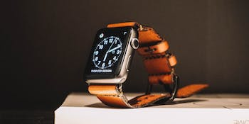 Apple Watch leather strap lying on table