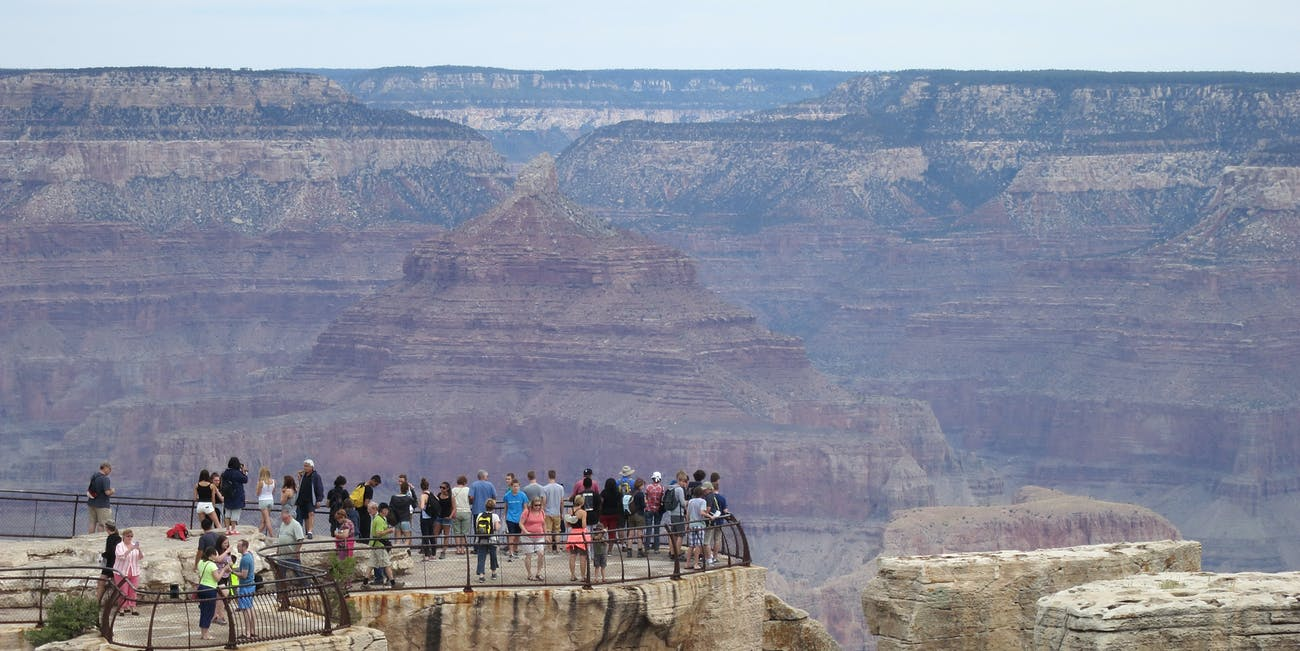 GRAND CANYON NATIONAL PARK, AR - JULY 14: Visitors stand at the Grand Canyon South Rim on July 14, 2014 at Grand Canyon National Park, Arizona. The Grand Canyon is among the state's biggest tourist destinations. (Photo by Sean Gallup/Getty Images)