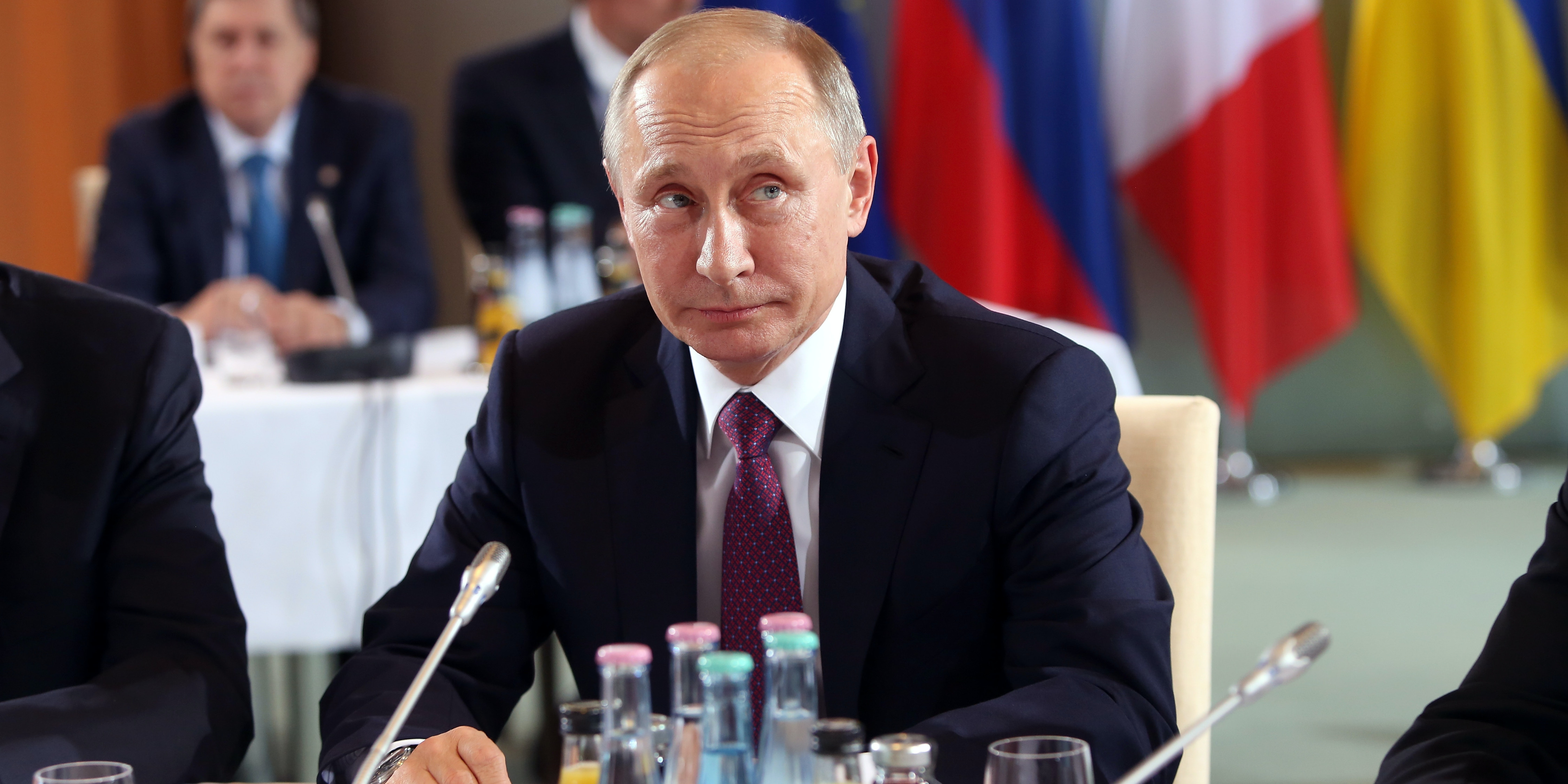 Russian President Vladimir Putin attends a meeting to discuss the Ukrainian peace process at the German federal Chancellery on October 19, 2016 in Berlin, Germany. The leaders of Russia, Ukraine, France and Germany, known as the Normandy Four, met in Berlin to discuss implementation of the peace plan known as the Minsk Protocol, a roadmap for resolving the conflict in Ukraine after Russian forces invaded in 2014 and annexed the peninsula of Crimea. The United States has threatened renewed sanctions on Russia if the country did not either implement the plan in the coming months or arrive at a plan on how to do so.