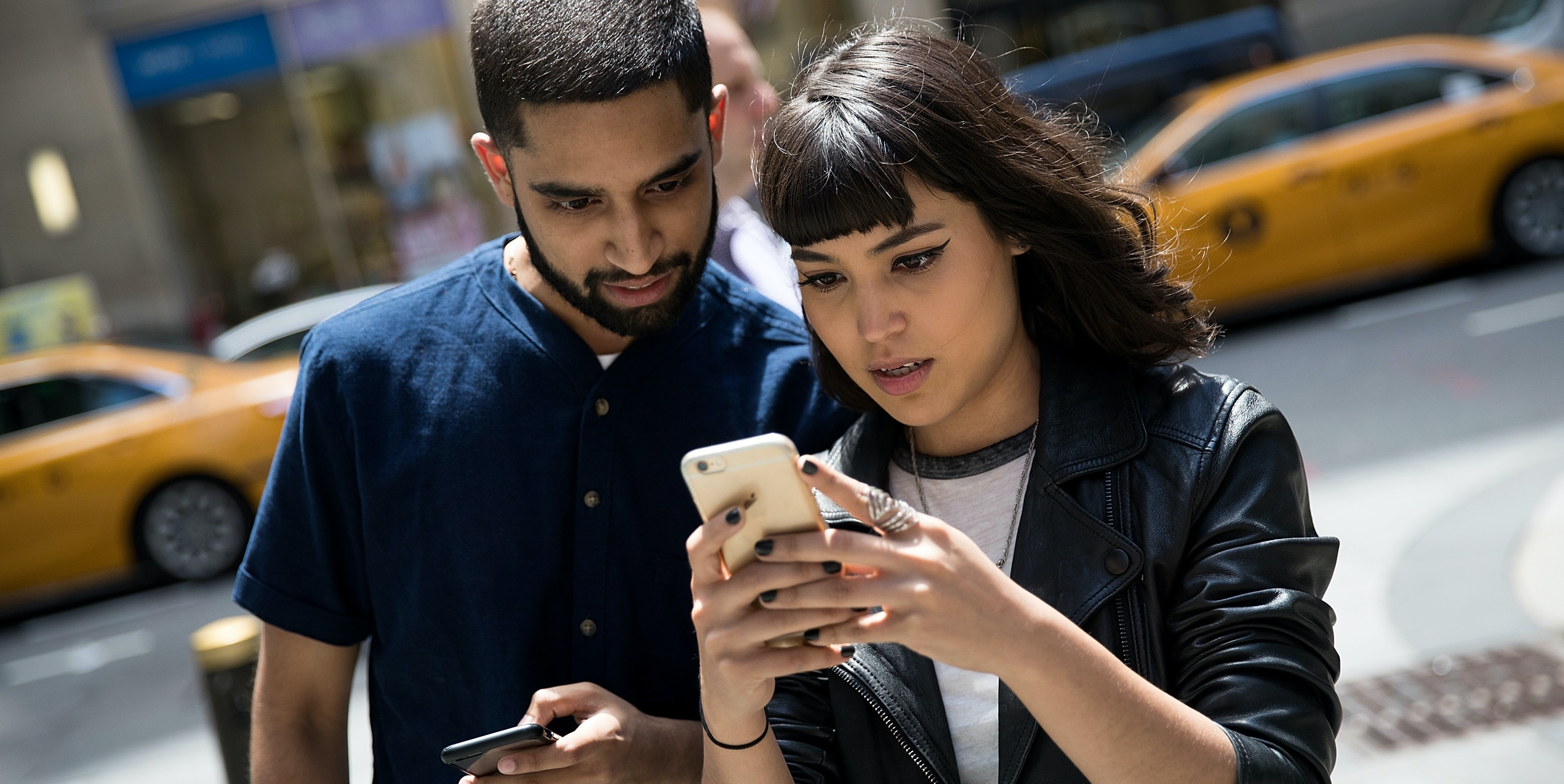 NEW YORK, NY - JULY 11: (L to R) Sameer Uddin and Michelle Macias play Pokemon Go on their smartphones outside of Nintendo's flagship store, July 11, 2016 in New York City.  The success of Nintendo's new smartphone game, Pokemon Go, has sent shares of Nintendo soaring. (Photo by Drew Angerer/Getty Images)