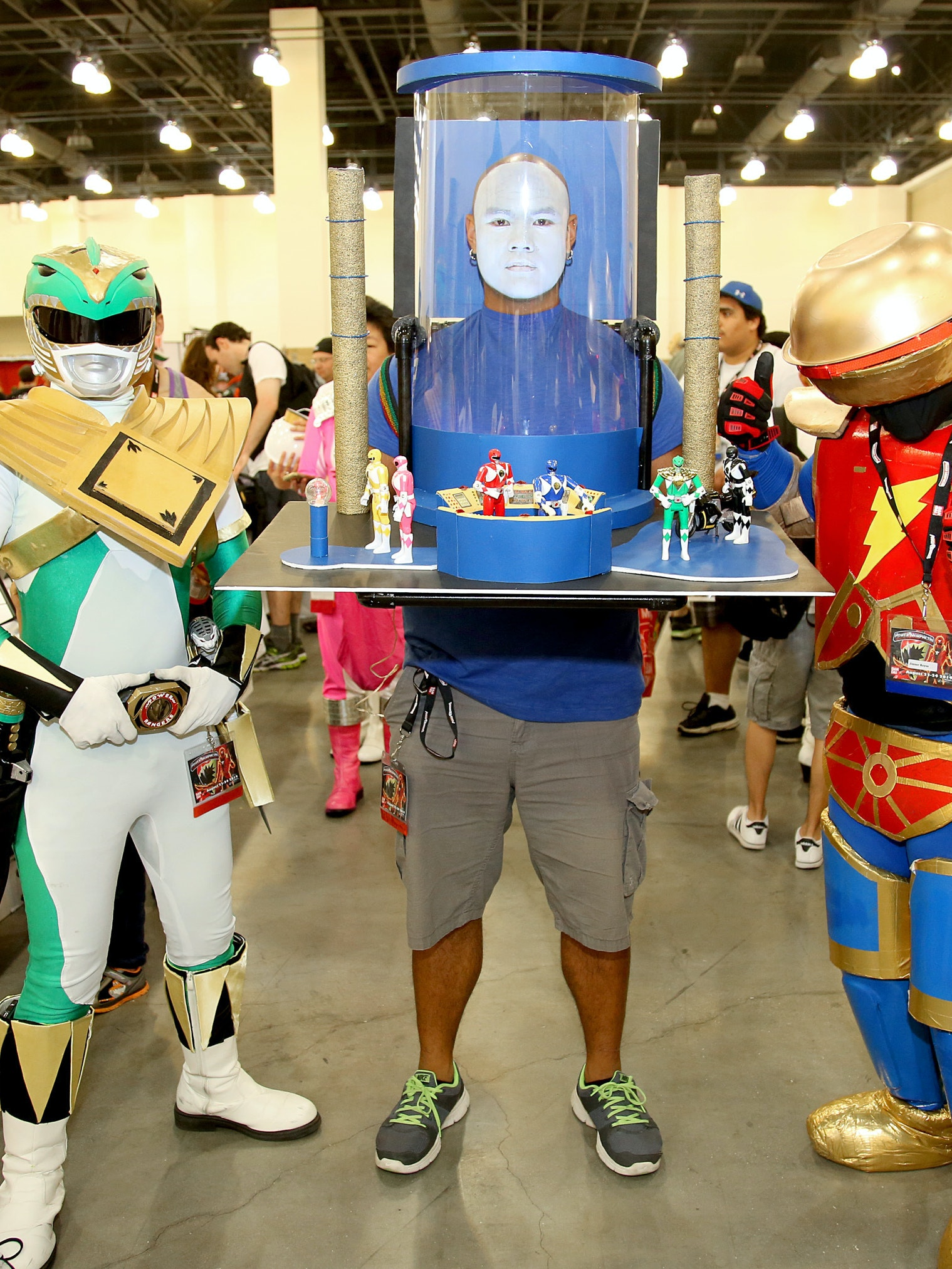 PASADENA, CA - AUGUST 23: Three dedicated Power Rangers fans attended Power Morphicon today and dressed up as the legendary Tommy Oliver, Alpha 5 and Zordon in the Command Center from Mighty Morphin Power Rangers on August 23, 2014 in Pasadena, California.  (Photo by Rachel Murray/Getty Images for Saban Brands)