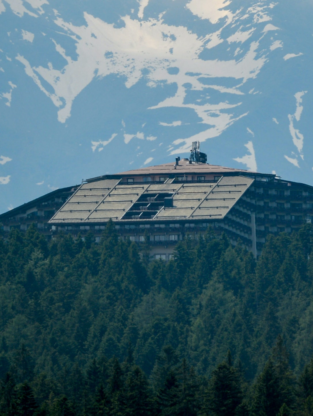 The Interalpen-Hotel Tirol, venue of the Bilderberg conference, is seen behind trees on a ridge on June 11, 2015.