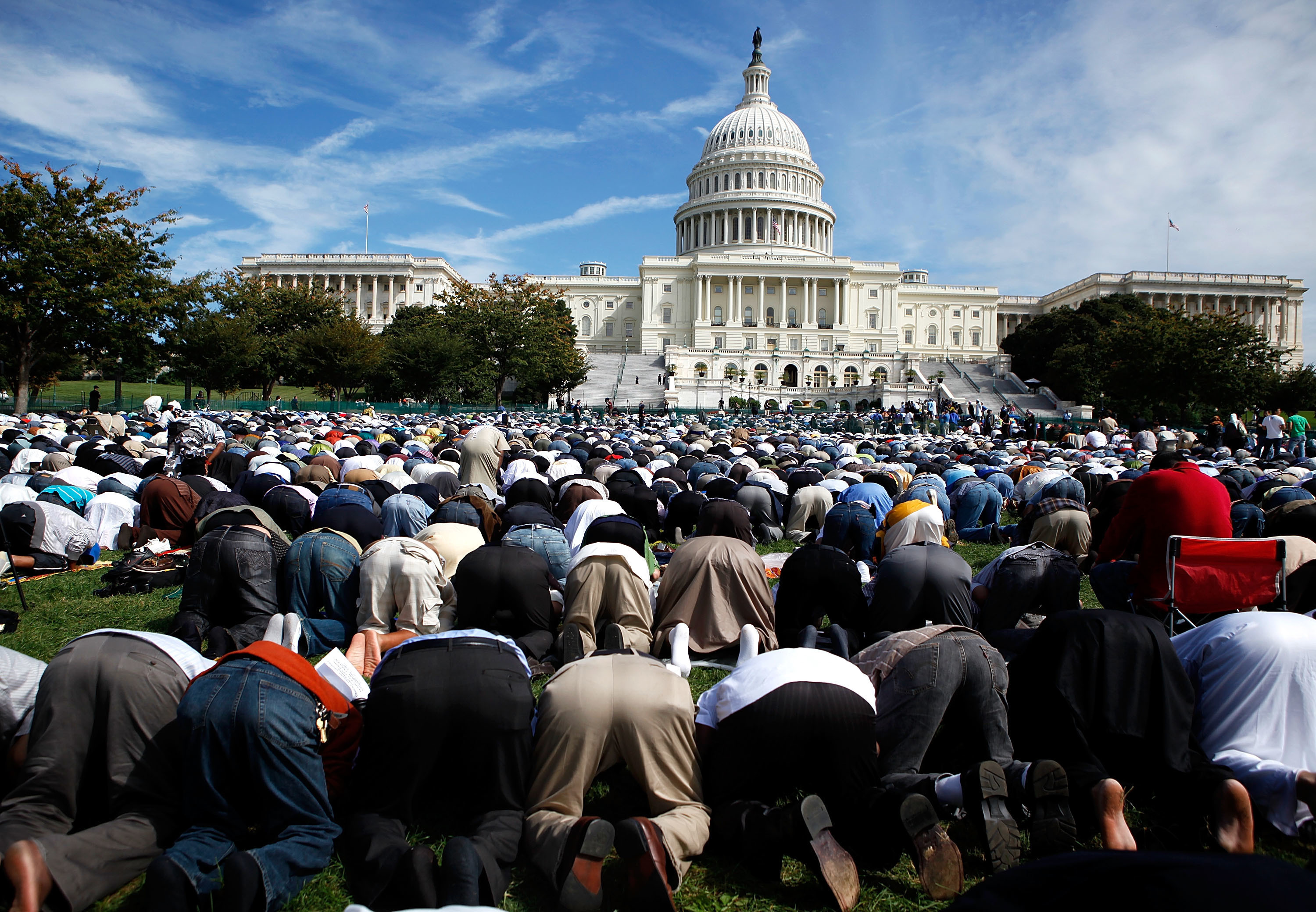 Muslims say prayer during the 'Islam on Capitol Hill 2009' event at the West Front Lawn of the U.S. Capitol September 25, 2009 in Washington, DC. Thousands of Muslims gathered for the event to promote the diversity of Islam.