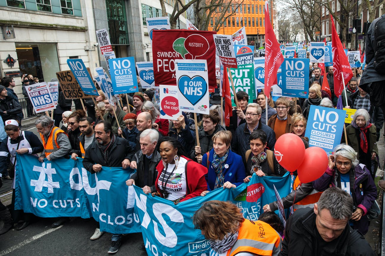 LONDON, ENGLAND - MARCH 04: Protesters carry banners and placards through central London during a demonstration in support of the NHS on March 4, 2017 in London, England. Thousands march from Tavistock Square to Parliament today for a demonstration against hospital closures, privatisation and cuts to the NHS. (Photo by Jack Taylor/Getty Images)