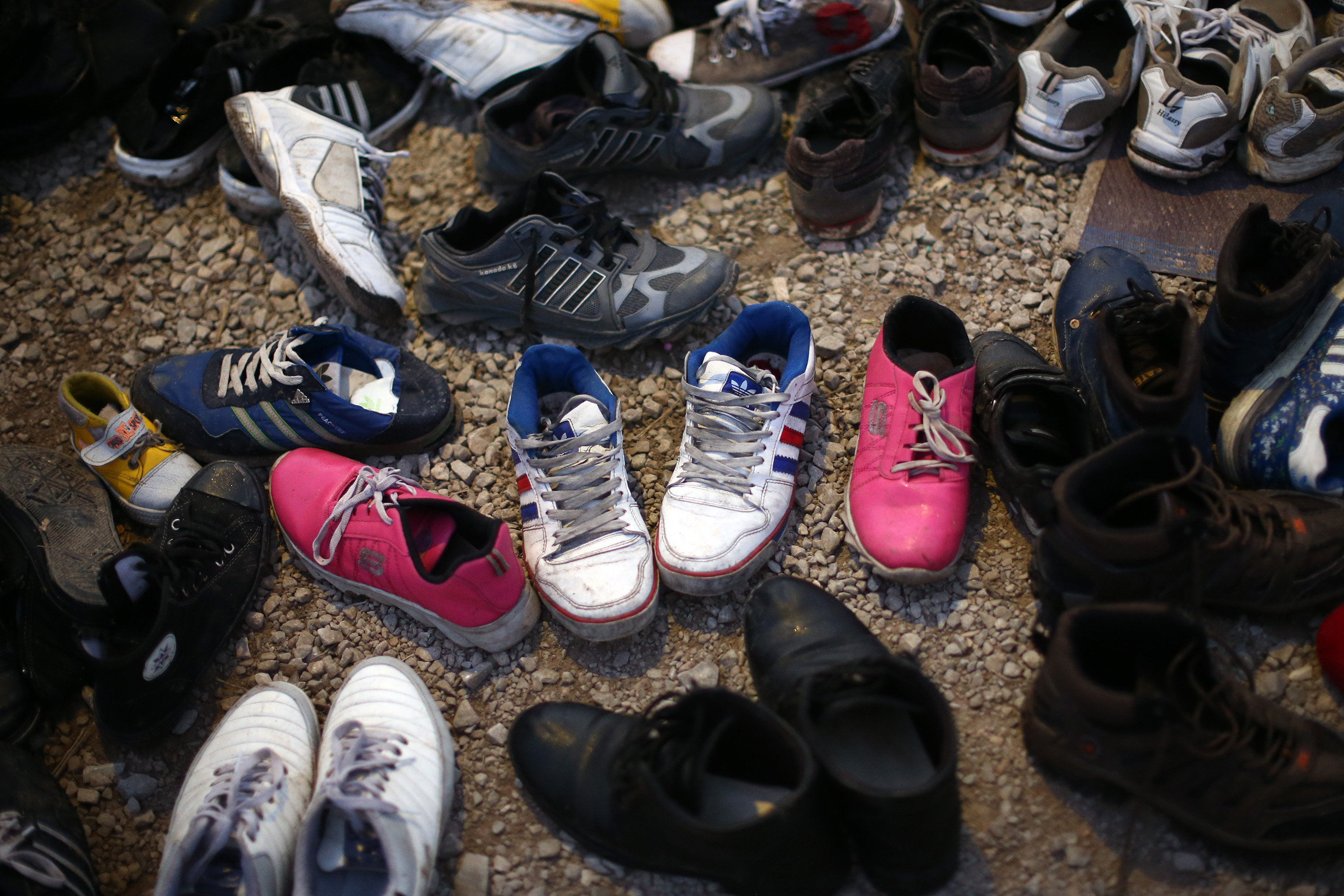 Migrants shoes are laid out to dry in a reception centre after they made the crossing from Turkey to the Greek island of Lesbos on November 14, 2015 in Sikaminias, Greece.