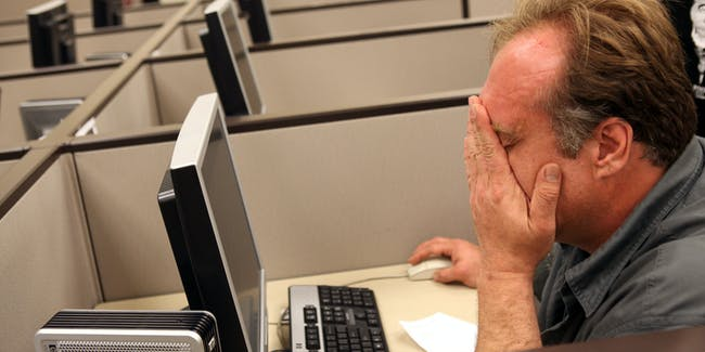 OAKLAND, CA - AUGUST 05:  John Heckert wipes his eyes as he uses a computer to fill out paperwork for unemployment insurance at Eastbay Works Oakland One-Stop Career Center August 5, 2010 in Oakland, California. U.S. jobless claims unexpectedly rose by 19,000 new claims for the week ending on July 31. (Photo by Justin Sullivan/Getty Images)