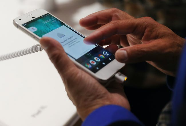 A person tries a new Google Pixel phone at the Google pop-up shop in the SoHo neighborhood on October 20, 2016 in New York City.