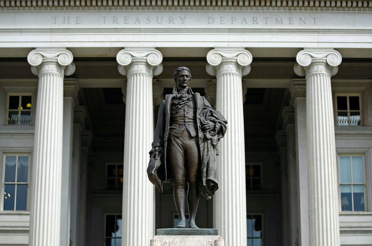 WASHINGTON - SEPTEMBER 19: A statue of the first United States Secretary of the Treasury Alexander Hamilton stands in front of the U.S. Treasury September 19, 2008 in Washington, DC. Treasury Secretary Henry Paulson announced that the Treasury will insure money market mutual funds as one part of a massive government bailout that is attempting to stabilize the current financial crisis. (Photo by Chip Somodevilla/Getty Images)