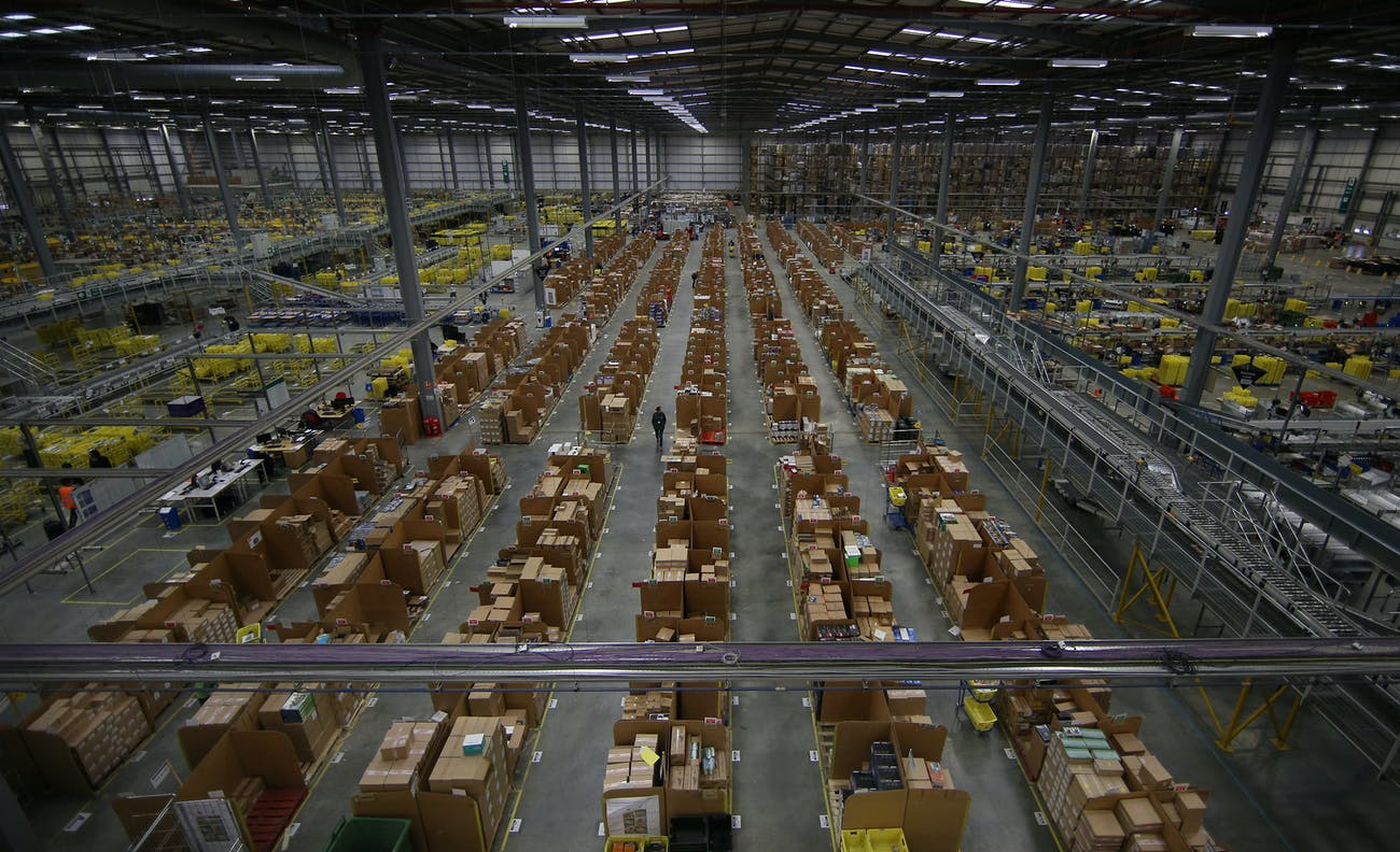 HEMEL HEMPSTEAD, ENGLAND - DECEMBER 05: Parcels are prepared for dispatch at Amazon's warehouse on December 5, 2014 in Hemel Hempstead, England. In the lead up to Christmas, Amazon is experiencing the busiest time of the year. (Photo by Peter Macdiarmid/Getty Images)