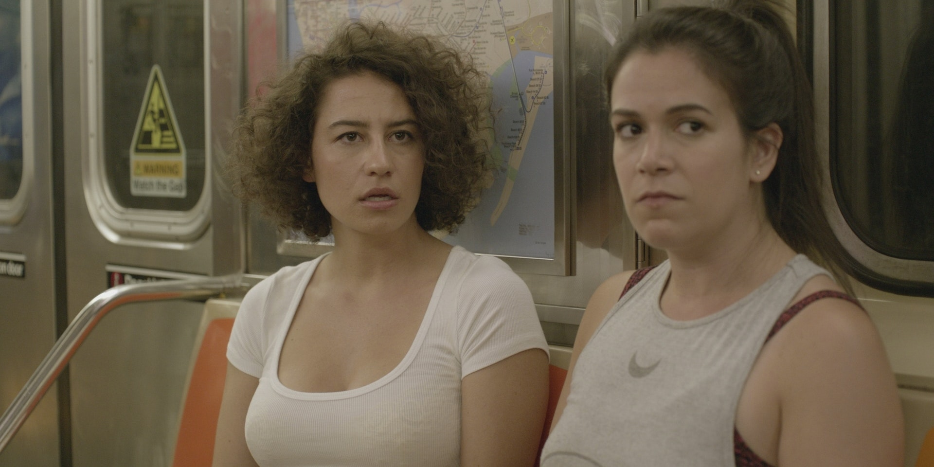"Ilana and Abbi stuck on the subway in ""Getting There"""