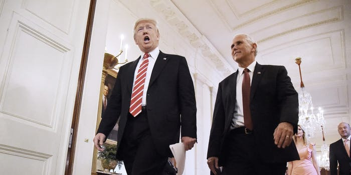 WASHINGTON, DC - JUNE 22: (AFP OUT) U.S President Donald Trump (L) and Vice-President Mike Pence arrive in the East Room to participates in the American Leadership in Emerging Technology Event at the White House June 22, 2017 in Washington, DC. (Photo by Olivier Douliery-Pool/Getty Images)