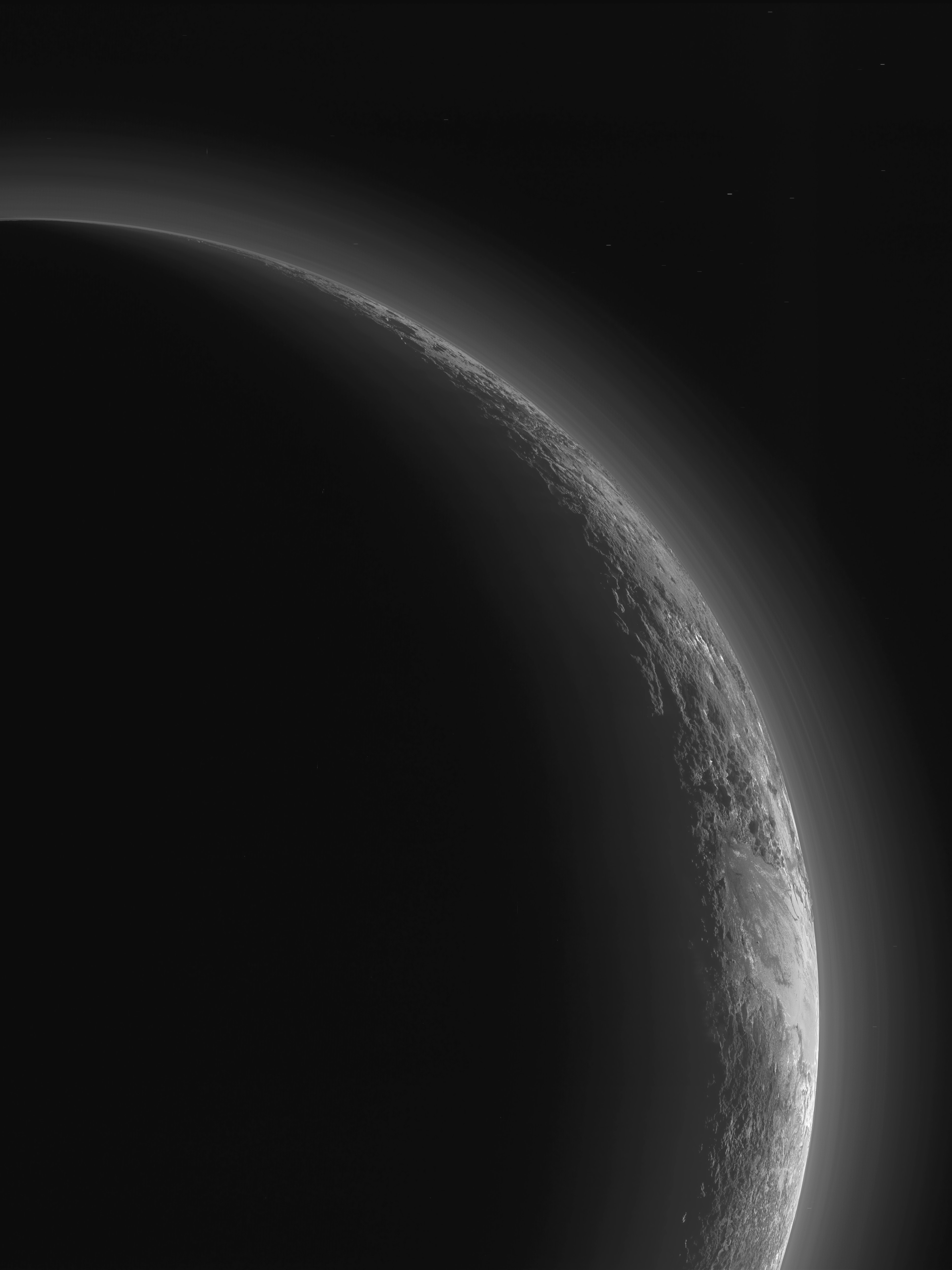 The New Horizons team released an image of Pluto's crescent, gathered from New Horizons' flyby of Pluto in 2015.