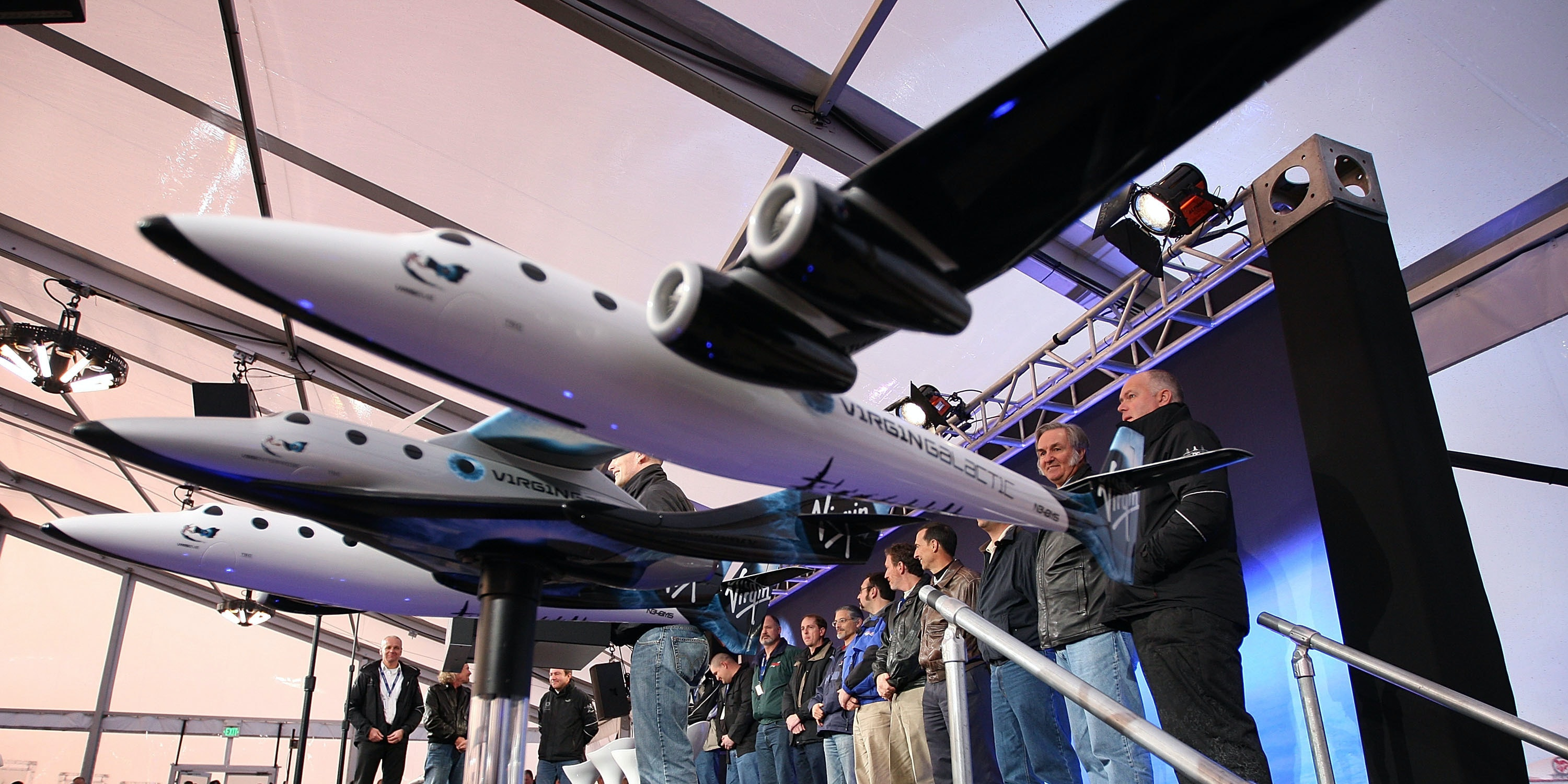 MOJAVE, CA - DECEMBER 7:  Project team members are introduced as Virgin Galactic unveils its new SpaceShipTwo spacecraft at the Mojave Spaceport on December 7, 2009 near Mojave, California. The eight-person VSS Enterprise, named after the Star Trek ship of the same name, is the first of a series of space-planes for customers of Virgin Galactic who have paid around $200,000 for a suborbital flight into space. British entrepreneur Sir Richard Branson is financing the spacecraft and aerospace designer Burt Rutan is building it through The Spaceship Company, a joint venture of Scaled Composites and Virgin Group.   (Photo by David McNew/Getty Images)