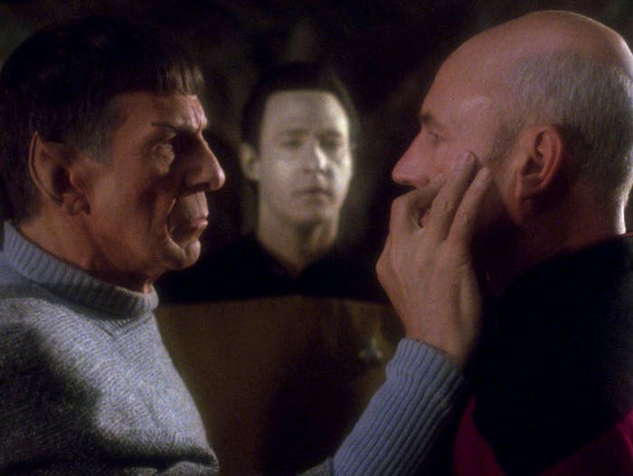 "Spock (Leonard Nimoy) mind-melds with Captain Picard (Patrick Stewart) in the two-part crossover episode ""Unification."""