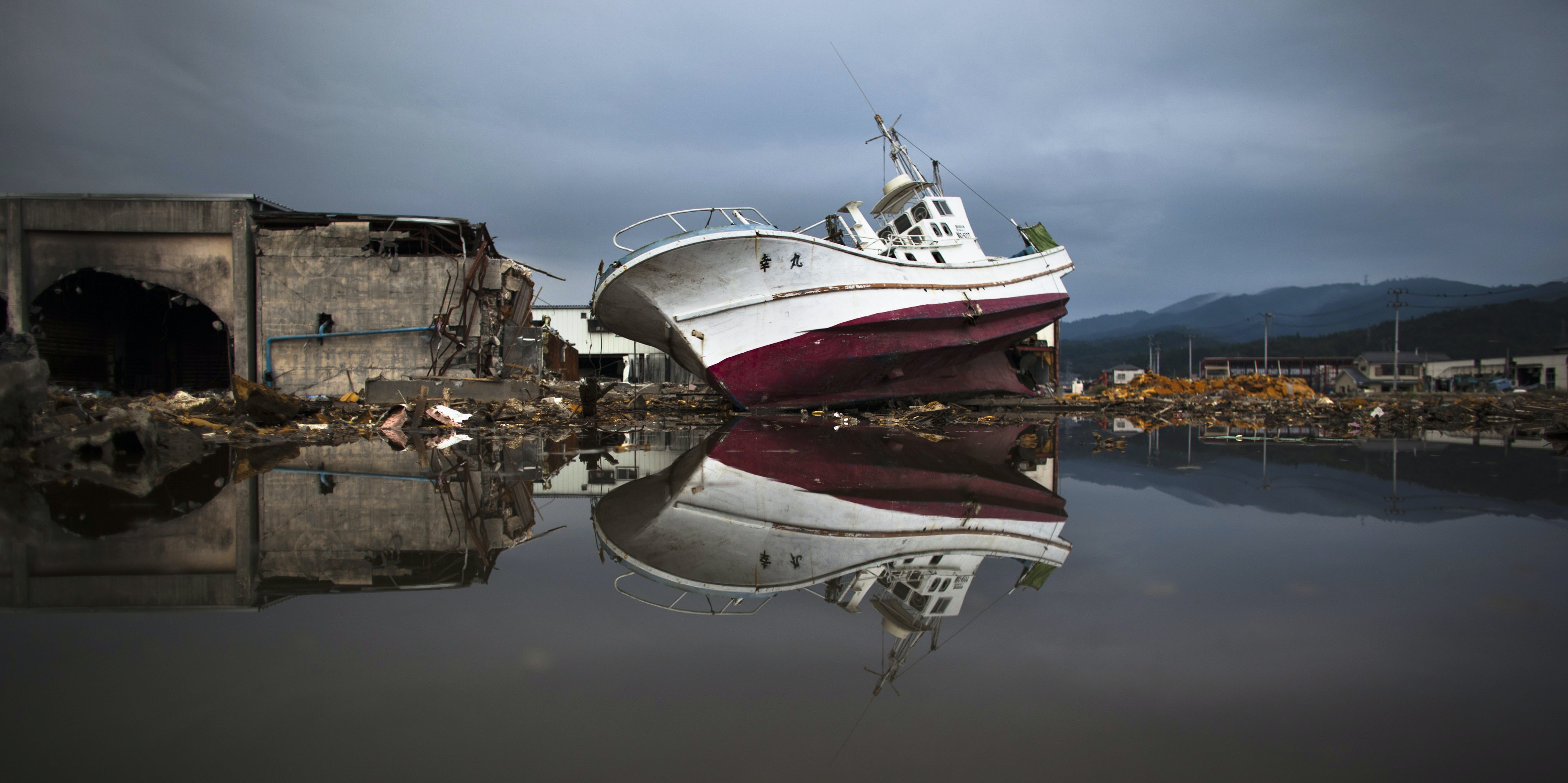 A devasted area is seen prior to the sixth month anniversary of the March 11 earthquake and massive tsunami on September 10, 2011 in Kesennuma, Miyagi Prefecture, Japan. A 9.0 magnitude strong earthquake struck Japan offshore on March 11 at 2:46pm local time, triggering a tsunami wave of up to ten metres which engulfed large parts of north-eastern Japan and also damaging the Fukushima nuclear plant, causing the worst nuclear crisis in decades. The current number of dead and missing is reportedly estimated to be 22,900.