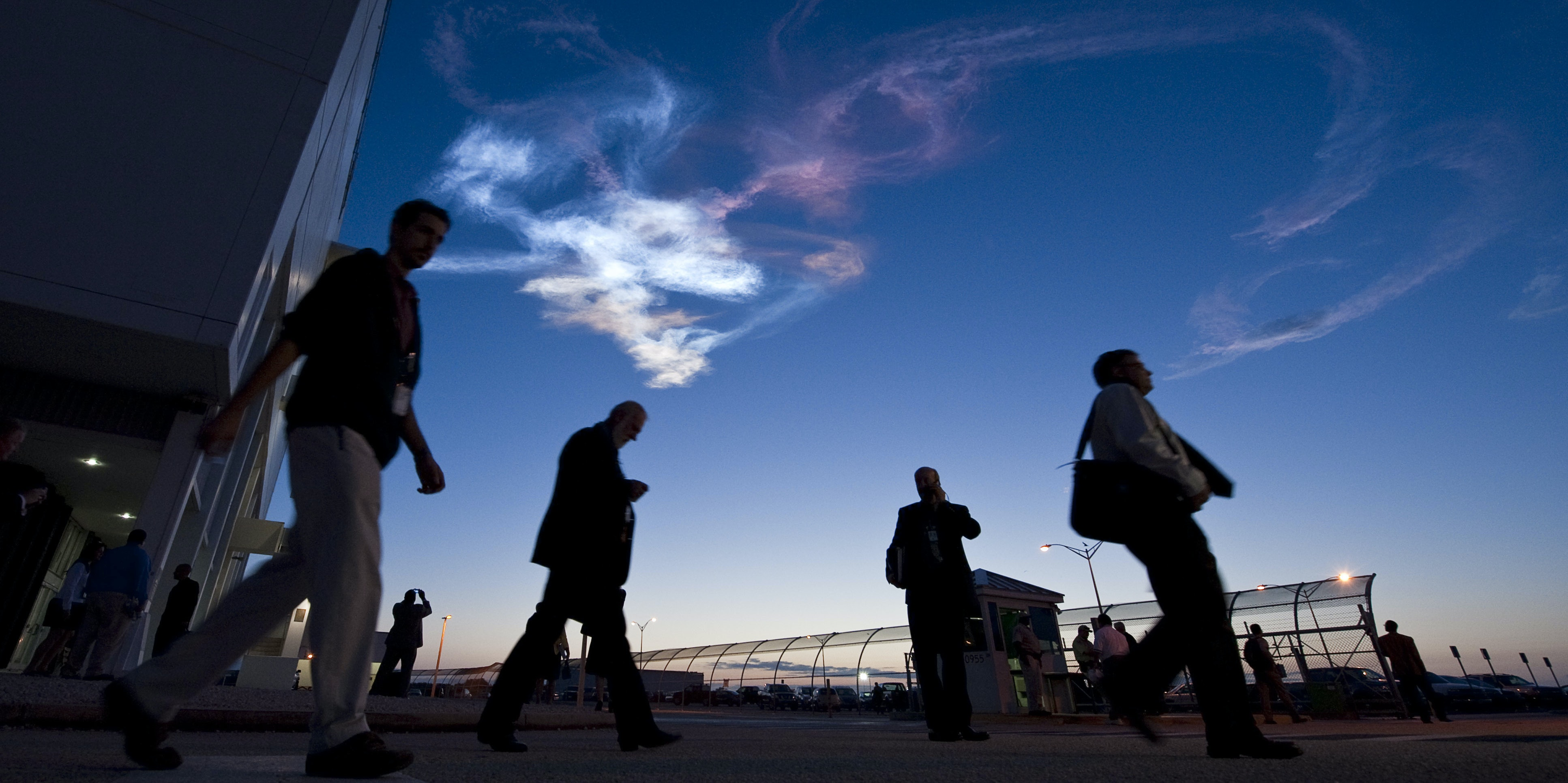 CAPE CANAVERAL, FL - APRIL 5: In this handout image provided by NASA, contrails are seen as workers leave the Launch Control Center after the launch of the space shuttle Discovery and the start of the STS-131 mission at NASA Kennedy Space Center in Cape Canaveral, Fla. on Monday April 5, 2010. Discovery is carrying a multi-purpose logistics module filled with science racks for the laboratories aboard the station. The mission has three planned spacewalks, with work to include replacing an ammonia tank assembly, retrieving a Japanese experiment from the station's exterior, and switching out a rate gyro assembly on the station's truss structure. (Photo by Bill Ingalls/NASA via Getty Images)