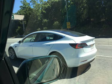 Pre-Release Tesla Model 3 Spotted with Stunning Glass Roof