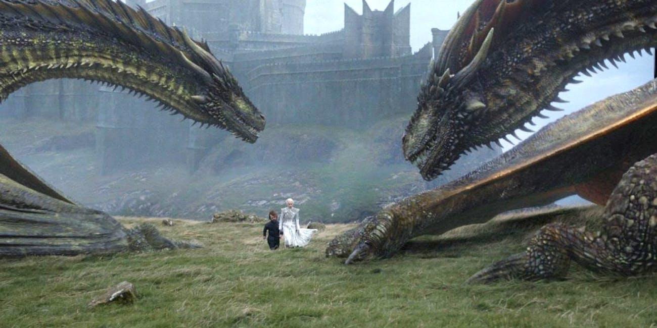On Dragonstone, Tyrion and Daenerys walk near Rhaegal and Viserion.