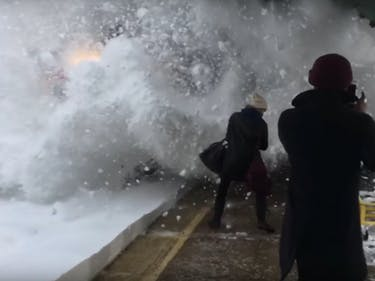 Watch a Bunch of Suckers Get Demolished by Snow When a Train Flies By