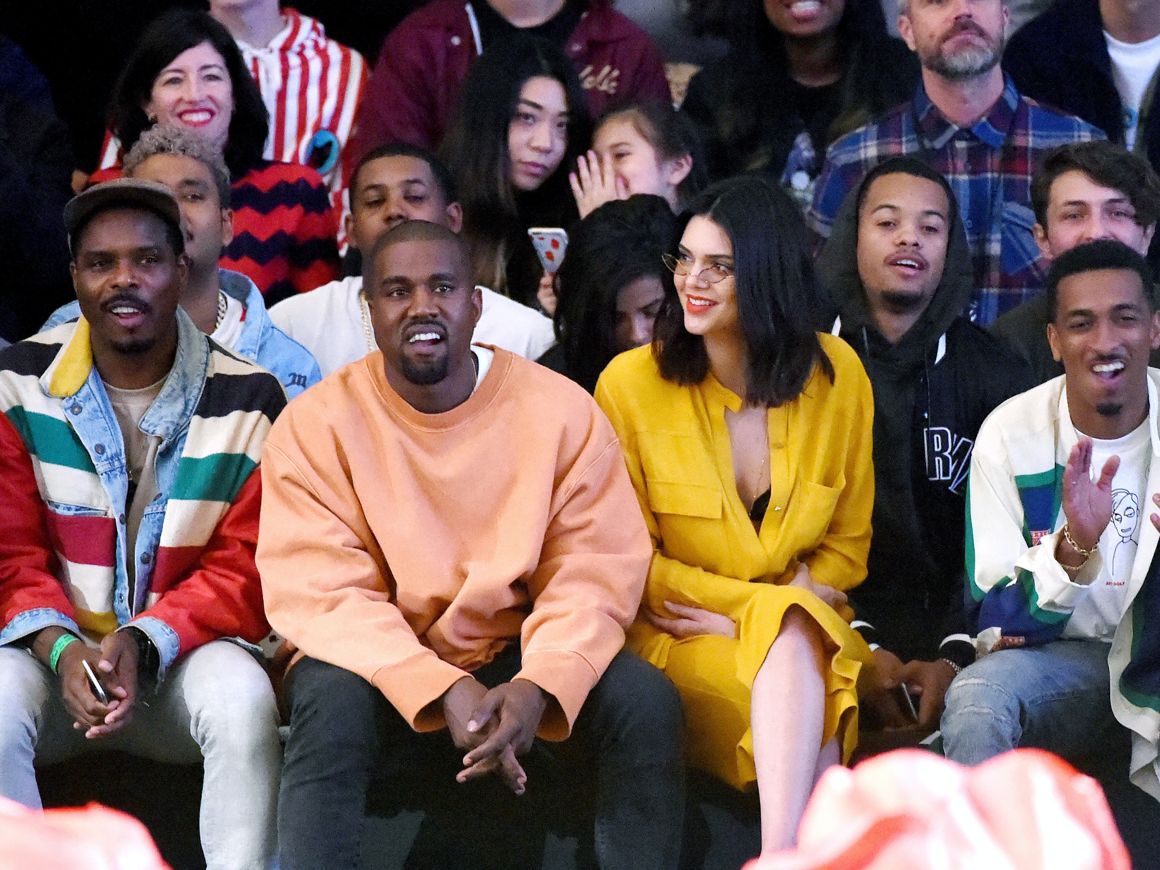 Hip hop artist/designer/producer Kanye West (L) and model Kendall Jenner attend Tyler, the Creator's fashion show for Made LA at L.A. Live on June 11, 2016 in Los Angeles, California.  (Photo by Kevin Winter/Getty Images)