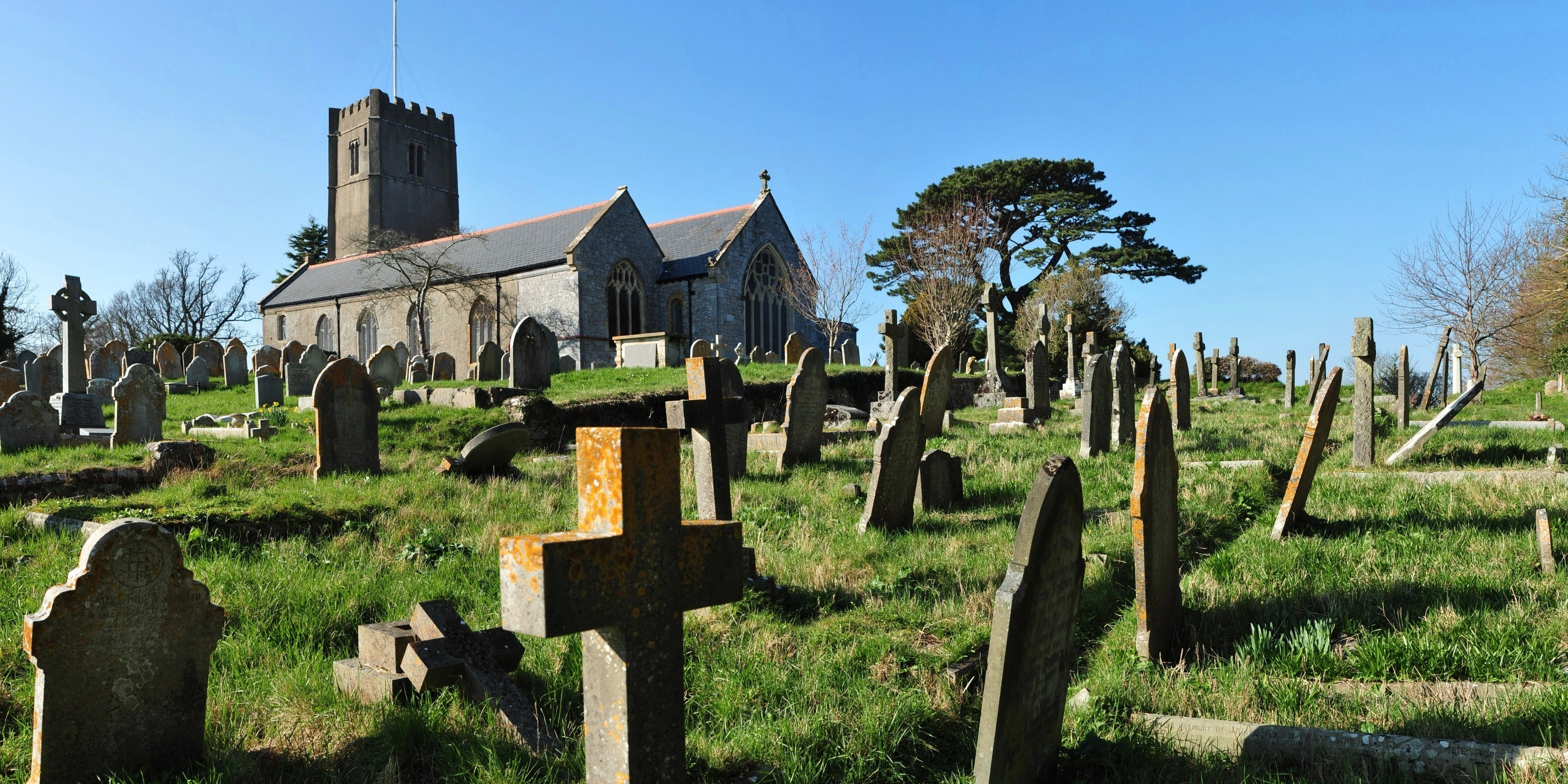 All Saints Church and its graveyard in Highweek, Devon, England.