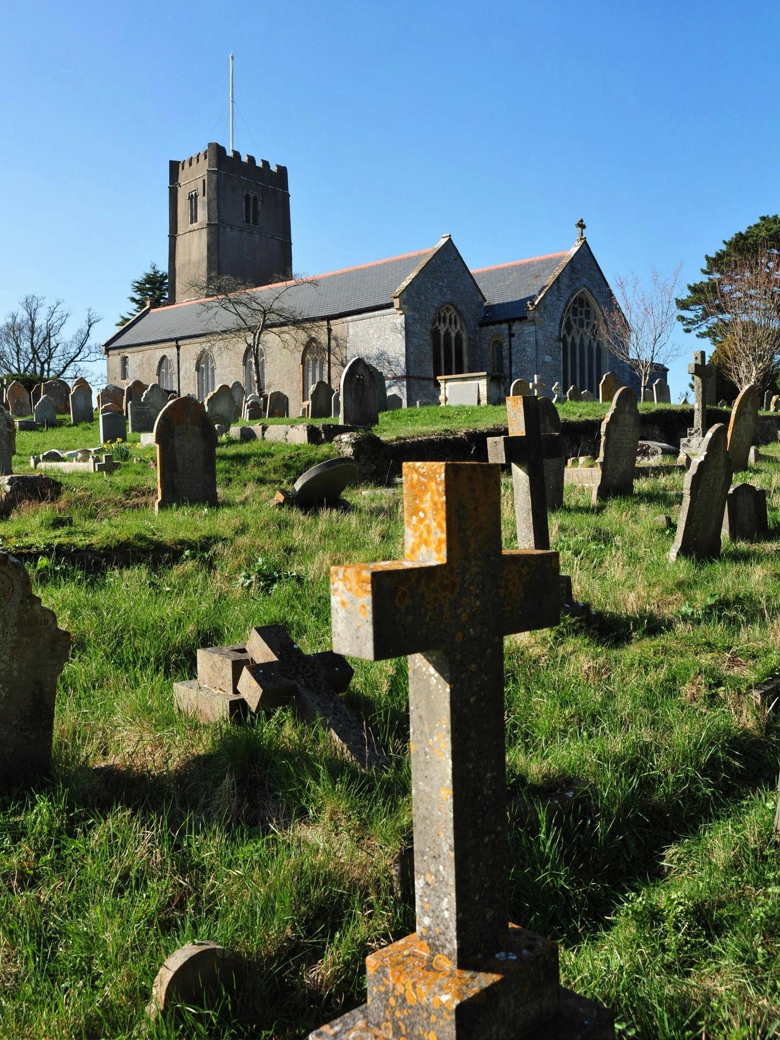 All Saints Church and its graveyard in Highweek, Devon, England.