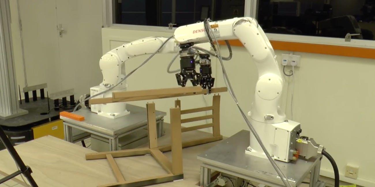robots building ikea chair