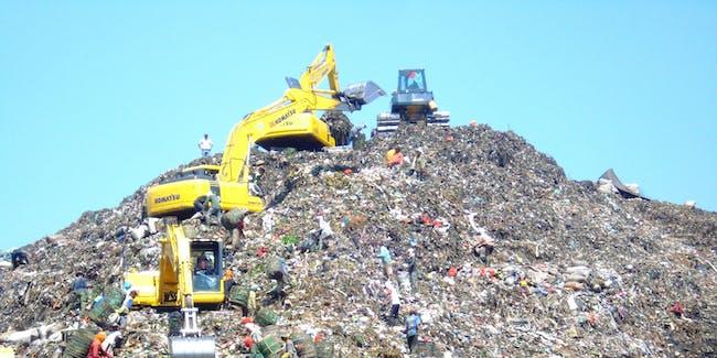 Mountain of garbage in Bantar Gebang with some excavator (Indonesia).