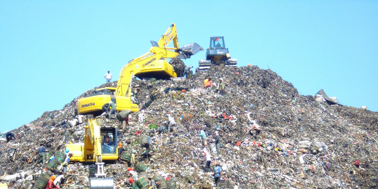 Mountain of garbage in Bantar Gebang with some excavator (Indonesia).