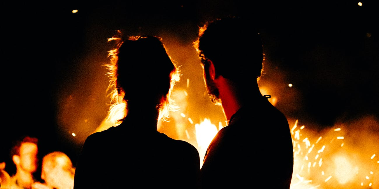 couple in front of fire