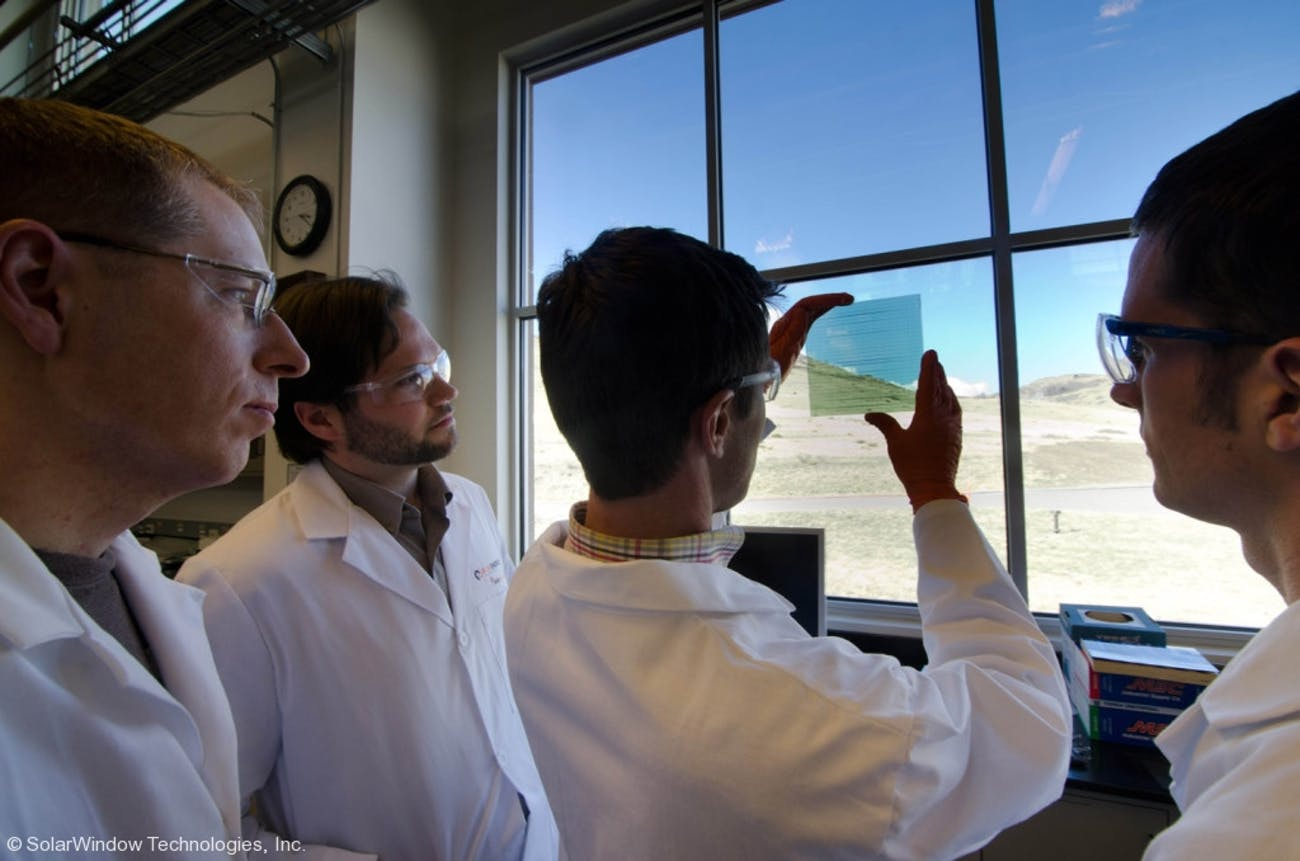 Researchers view the Colorado rocky mountains through SolarWindow glass.