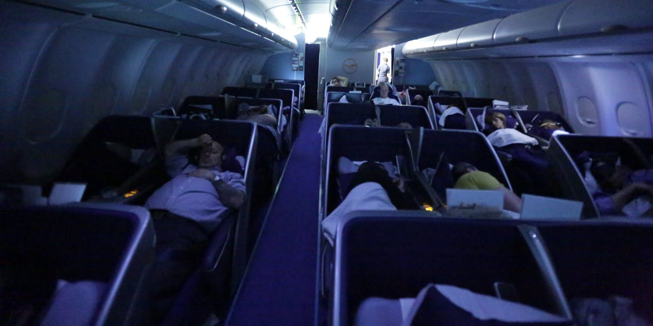 How to Sleep on a Plane | Inverse