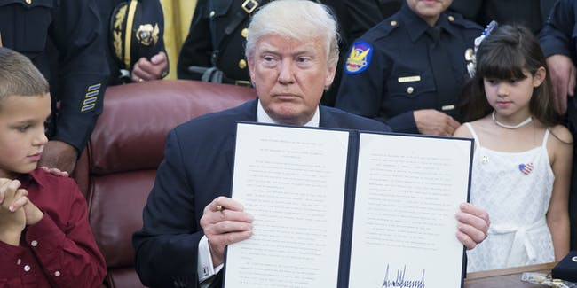 U.S. President Donald Trump signs a proclamation supporting police officers at the White House on May 15, 2017 in Washington, DC.