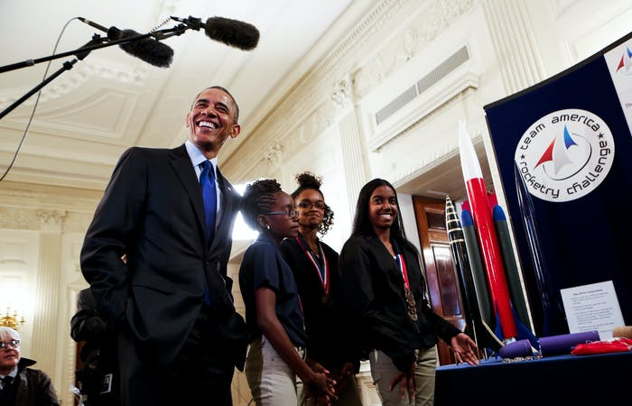 Obama listens to Stephanie Bullock  (R) who is part of a team from the U.S. Virgin Islands that designed rockets for the Team America Rocketry Challenge, at the 2015 White House Science Fair March 23, 2015 in Washington, DC.