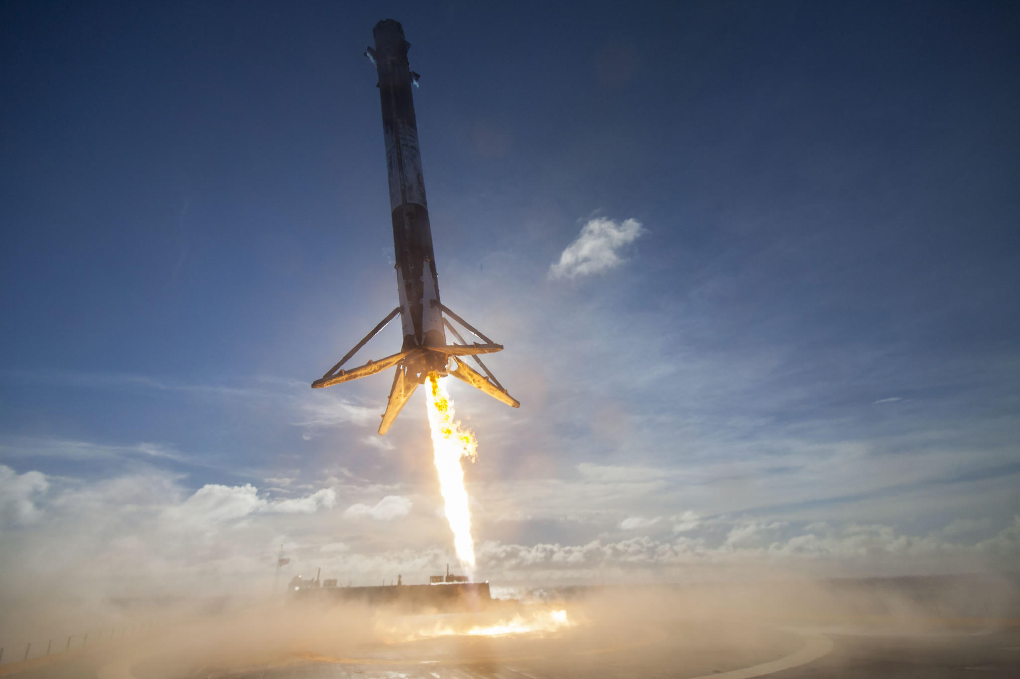 SpaceX's Falcon 9 touches down on a droneship in the Atlantic Ocean.