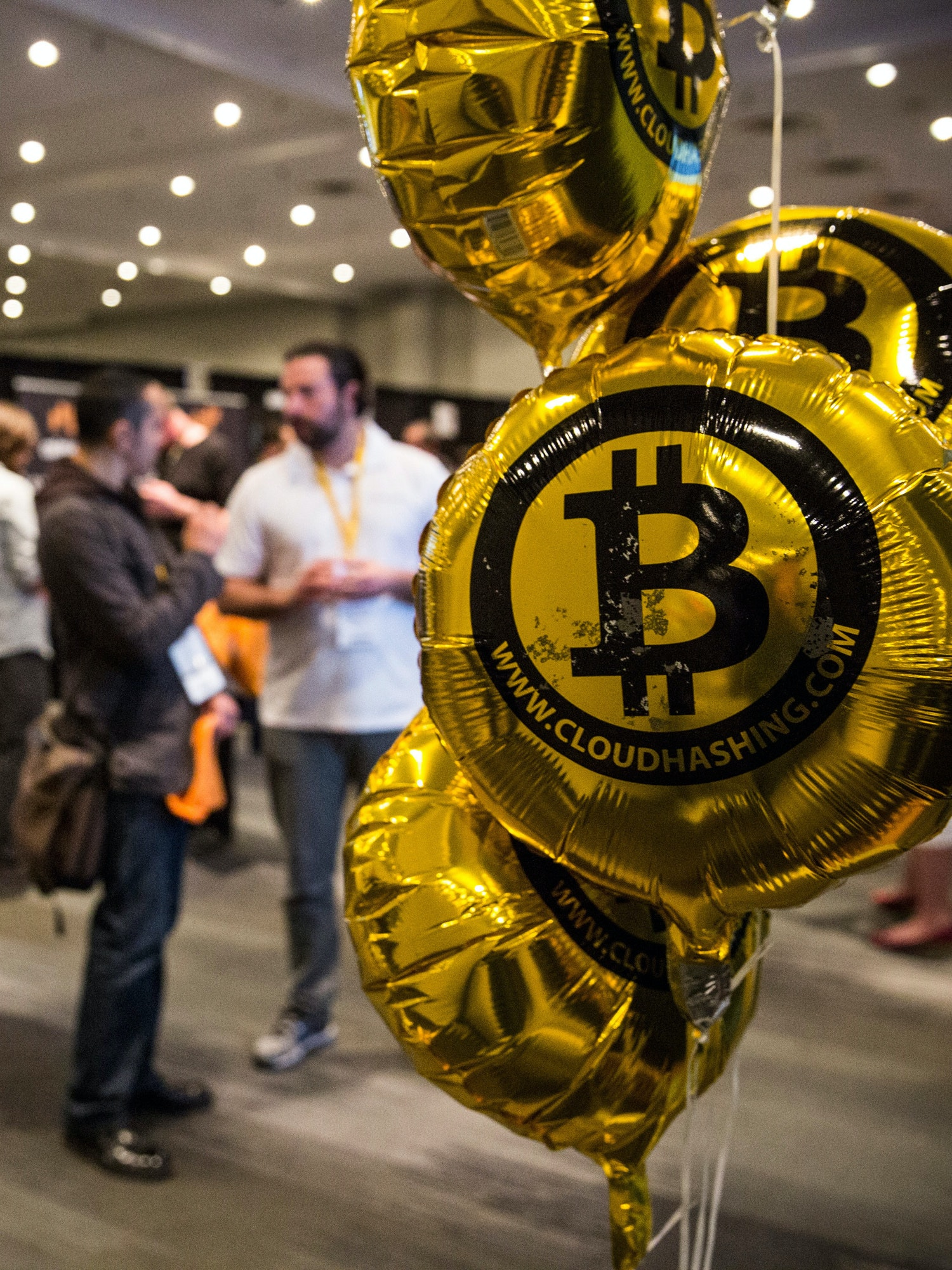 NEW YORK, NY - APRIL 07:  People attend a Bitcoin conference on at the Javits Center April 7, 2014 in New York City. Topics included market places to trade bitcoin, mining hardware to harvest bitcoins and digital wallets to store bitcoins. Bitcoin is one of the most popular of over one hundred digital currencies that have recently come into popularity.  (Photo by Andrew Burton/Getty Images)