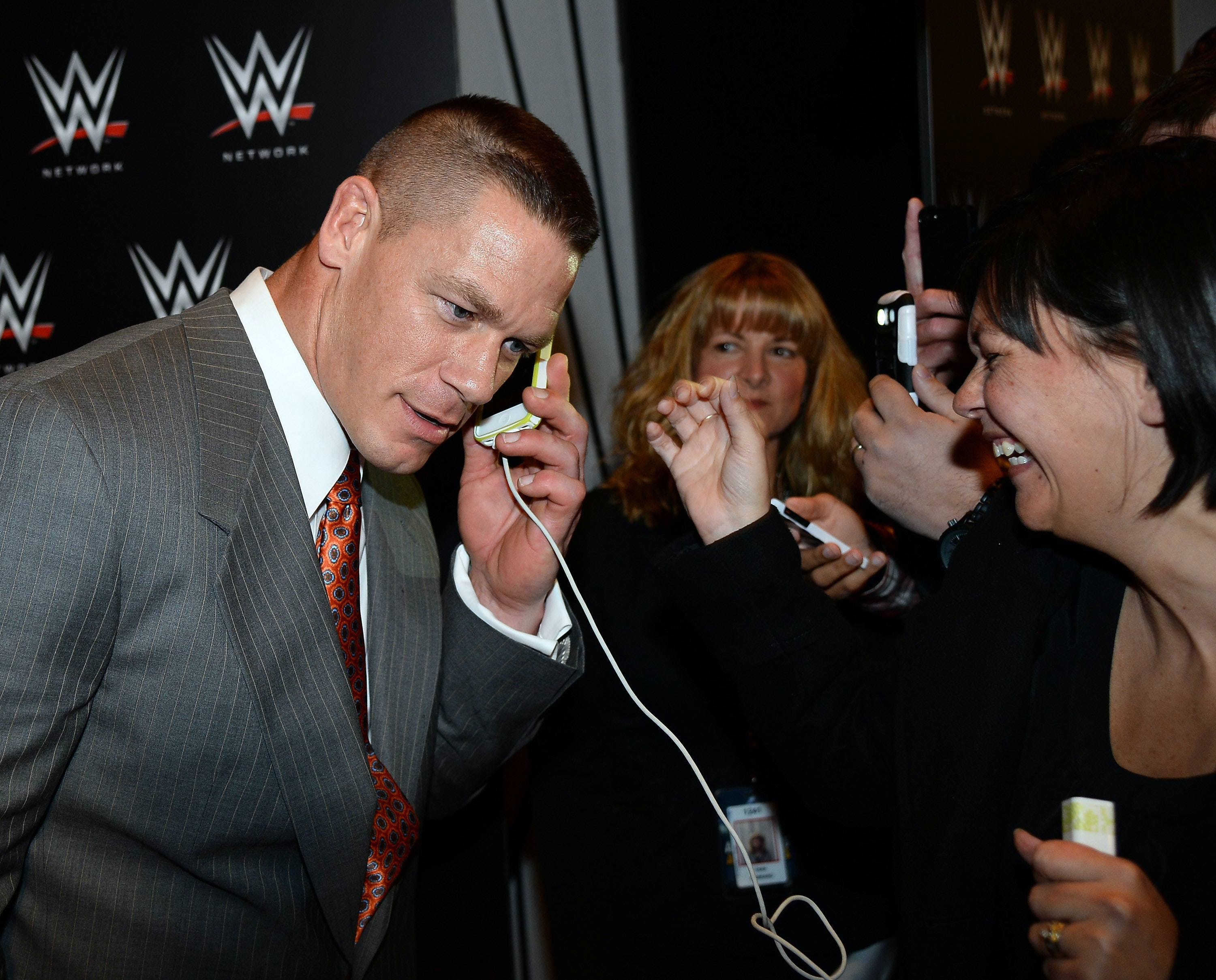 wwe wrestler john cena speaks to a fan on a cell phone at a news conference announcing the wwe netwo?rect=0%2C312%2C3000%2C1502&auto=format%2Ccompress&w=650 john cena reminds everyone about his personal meme with iphone tweet