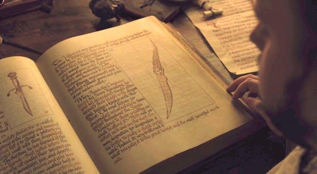 Sam reads up on the Dragonglass decoration customs of House Targaryen.