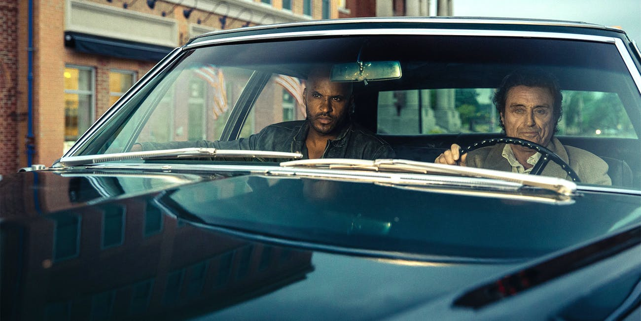 Ricky Whittle and Ian McShane in 'American Gods'